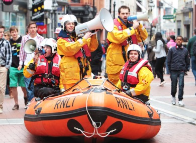 It wasn't THAT rainy, surely? RNLI volunteers launch their annual MAYDAY fundraising campaign on Grafton Street today.