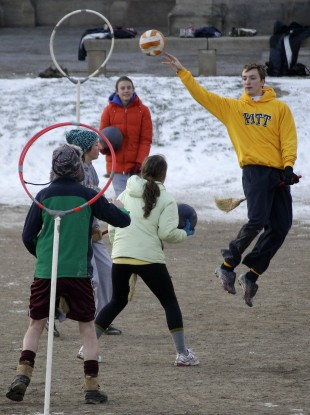 University of Pittsburgh student Andrew Bulman, right, of Bryn Mawr, Pa., leaps to make a pass during a Quidditch match in Pittsburgh 2012.