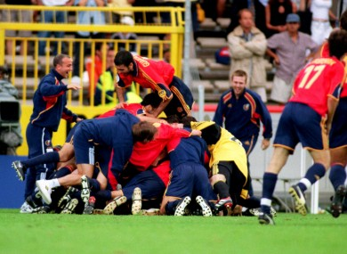 The Spanish players celebrate progression from the group stages.