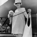 Barbra Streisand arrives with her pet poodle Sadie at Newport, Rhode Island in 1966. Streisand was making a one night appearance at a musical festival - and was expecting her first baby. (AP Photo/Press Association Images)