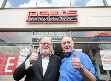 Ben Peat, left, and his nephew Ken Peat, who is sales director of Peats Electronics, outside the Parnell Street branch when it reopened on 28 April.