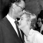 Actress Marilyn Monroe leans against her fiance, playwright Arthur Miller, in her apartment house in New York, June 22, 1956. (AP Photo)