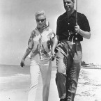 Actress Marilyn Monroe and ex-husband, former New York Yankees ball player Joe DiMaggio, walk the shores of a beach near Sarasota in 1961. (AP Photo)