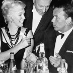 Marilyn Monroe talks to Frank Sinatra during a party on the set of the musical. (Press Association Images)