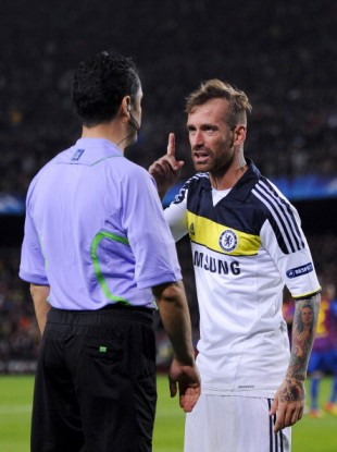 Chelsea's Raul Meireles berates an official during the Champions League semi-final at the Camp Nou.