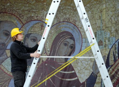 Workers put the finishing touches to the main stage at the Eucharistic Congress