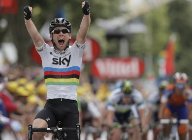 Mark Cavendish celebrates after winning Stage 18.