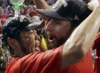 Texas Rangers' Koji Uehara of Japan and Scott Feldman celebrate in 2011.