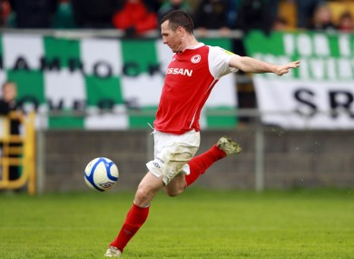 Pat Flynn blasts in the equalising goal for St Pat's.