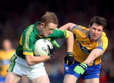 Kerry's Colm Cooper and Kevin Harnett of Clare.