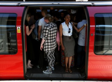 Commuters on an Underground train at Stratford, the main Olympic stop