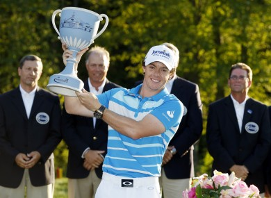 Rory McIlroy, of Northern Ireland, holds the trophy after winning the Deutsche Bank Championship.