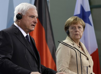 German Chancellor Angela Merkel, right, and the President of Panama, Ricardo Martinelli, left, address the media during a joint press conference.