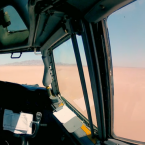 The jet is now remotely controlled by a pilot in a helicopter that flies beside it.