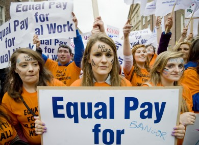 Young teachers attend a demonstration last month seeking equal pay with older counterparts. Many younger teachers are not entitled to the same allowances as older colleagues receive.