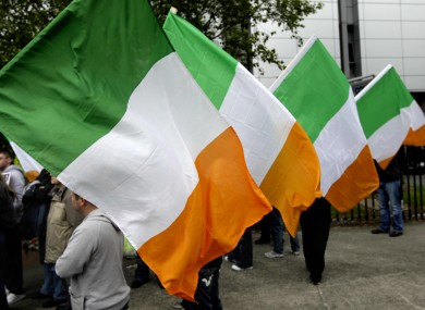 Éirígí supporters hold Irish flags at a protest last year (File photo)