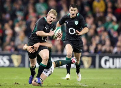 Keith Earls is stopped in his tracks by Francois Louw.