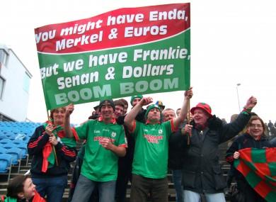 St Brigid's fans celebrate at McHale Park yesterday.