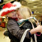 Vicky Gaffney from Waterford and has been living in Sydney for a year and a half is welcomed home for Christmas by her mother Breda Gaffney today at Dublin Airport. Photo: Mark Stedman/Photocall Ireland