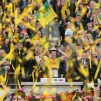 Michael meets Sam. The Donegal captain hoists the most famous trophy in Gaelic Football into the air. (INPHO/James Crombie).