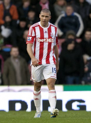 Stoke City's Jonathan Walters reacts after scoring an own goal during his team's English Premier League soccer match against Chelsea at the Britannia Stadium.