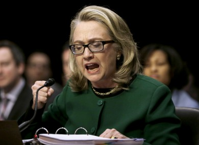 US Secretary of State Hillary Rodham Clinton pounding her fist as she testified on Capitol Hill in Washington today.