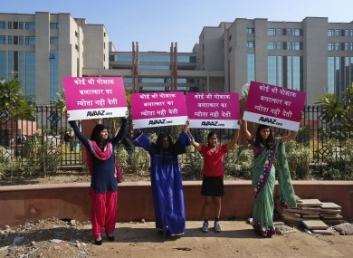 Women protesting outside the court where the accused in a gang rape of a 23-year-old woman will be tried.