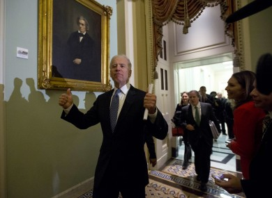 Vice-president Joe Biden gives a thumbs-up to reporters after a meeting of Democratic senators, shortly before the Senate approved a package to avoid the US's 'fiscal cliff'.