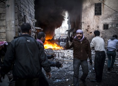 The scene of an explosion in Aleppo yesterday as violence continues in Syria.
