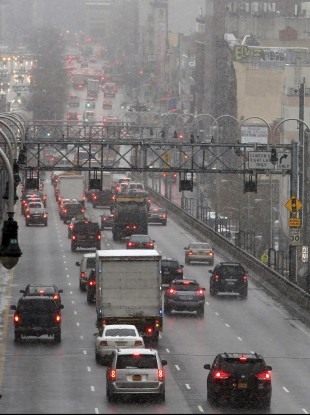 Morning rush hour traffic makes its way over the Williamsburg bridge into Manhattan.