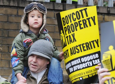 Derek Mac Anucaire and his son Tadhg, 3, from Inchicore at a protest outside the Revenue Computer Centre in Dublin last Saturday.