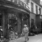 This lady is walking past what had been the Curzon Cinema, and the foyer has just been swept back in off the pavement.. Note the black flag which was part of the campaign over the republican prisoners, and the furniture for sale may be because people were losing their homes too.