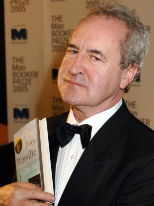 John Banville holds a copy of his book 'The Sea', which won the Man Booker Prize for fiction in 2005 (file photo).