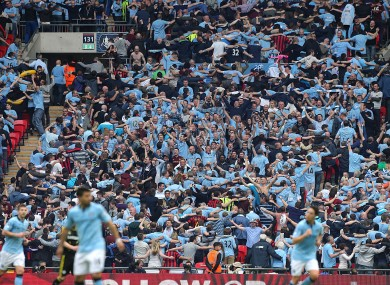 Manchester City's fans celebrate the opening goal by doing the Poznan.