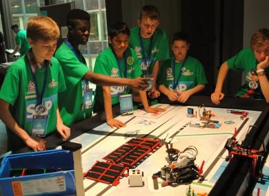 Team members Vlad Medves, Jonathan Toah, Himanshu Singh, Daire Hennessy, Luke Whelan and Jakub Palusinski watch their robot in action.