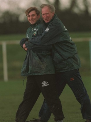 David Kelly enjoys a Jack Charlton hug in 1995.