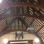 Tiered ceiling with beams.