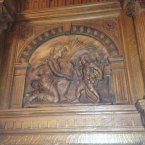 Elaborate carving on the fireplace.