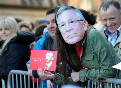 A Manchester United fan wearing a Sir Alex Ferguson mask during the parade.