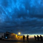 An Army carry team moves a transfer case containing the remains of Spc. Ray A. Ramirez at Dover Air Force Base, Del. According to the Department of Defense, Ramirez, 20, of Sacramento, Calif., died June 1, 2013 in Wardak province, Afghanistan of injuries sustained from an improvised explosive device. (AP Photo/Steve Ruark)