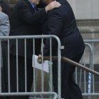 New Jersey Gov. Chris Christie, right, hugs actor Vincent Curatola. (AP Photo/Julio Cortez)