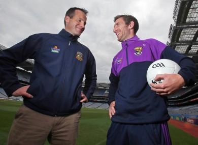 Meath manager Mick O'Dowd with Wexford footballer Redmond Barry.