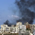 Black smoke rise from a burning house that was attacked during clashes that erupted between followers of a radical Sunni cleric Sheik Ahmad al-Assir and Shiite gunmen in the southern port city of Sidon, Lebanon. (AP Photo/Bilal Hussein)