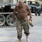 An injured Lebanese army solder walks in Sidon, Lebanon. (AP Photo/Bilal Hussein)