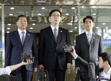 Chun Hae-sung, center, the head of South Korea's working-level delegation, speaks to the media while standing with delegates Kwon Young-yang, left, and Kang Jong-won before leaving for Panmunjom at the Office of the South Korea-North Korea Dialogue