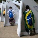 Catholics kneel at portable confessionals set up in Quinta da Boa Vista park during World Youth Day events in Rio de Janeiro. (AP Photo/Silvia Izquierdo)