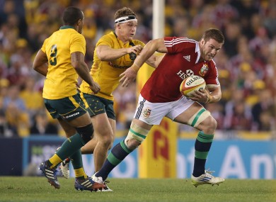 Sean O'Brien streaks away from Michael Hooper of Australia.