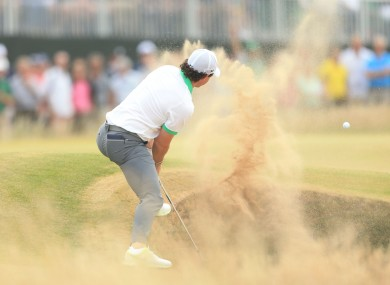 Rory McIlroy escapes from a bunker at Muirfield.