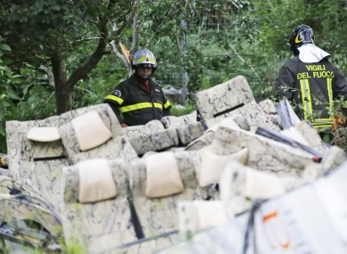 Firefighters assess the aftermath of the crash