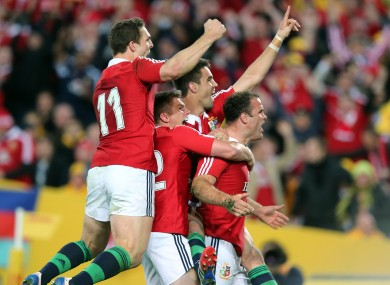 George North, Owen Farrell, Conor Murray and Jamie Roberts celebrate.